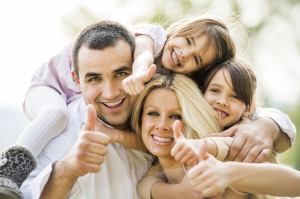 Family showing thumbs up.